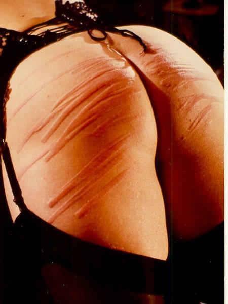 spanking com cane BDSM